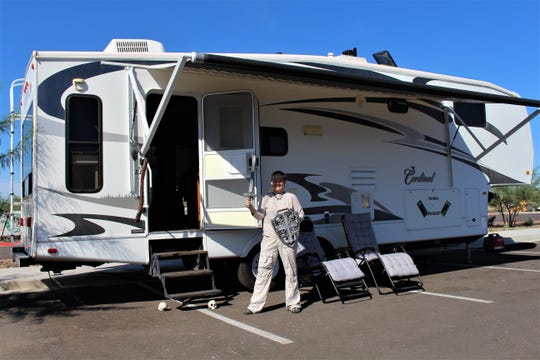 Jaime West in front of her trailer on Monday, Oct. 21. She and her husband arrived at the restaurant on Saturday, Oct. 19 in order to be first in line at Arizona's first White Castle. The restaurant opens on Wednesday, Oct. 23.