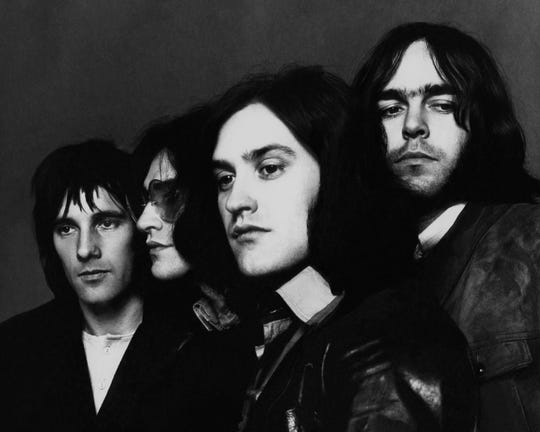 The Kinks, portrait of the band: far left, Mick Avory, center, brothers, Ray and Dave Davies, and John Dalton, far right.