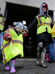 Kate Fiocchi and her daughter Ella, 2, of Dallastown, exit the registration area at the former Penn Mar Human Services building during the Trees for the Trail project Sunday, October 20, 2019. Kate, a Dallastown High School teacher, heads the school's Interact Club, a youth division of the Rotary Club. Volunteers planted 63 trees Sunday in an effort to replenish the original 1920s planting which was a memorial to WWI veterans. A dedication ceremony for the project will be Nov. 10 at Susquehannock High School. Bill Kalina photo