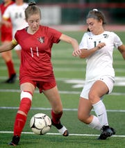 Susquehannock's Maddy Yoakum, left, and Twin Valley's Olivia Matherson vie for possession in District 3 Class 3-A soccer action at Susquehannock High School Monday, October 21, 2019. Bill Kalina photo