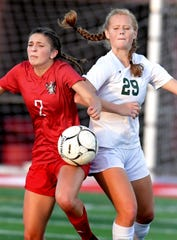 Susquehannock's Shelby Derkosh, left, and Twin Valley's Sophie Harple battle for possession in District 3 Class 3-A soccer action at Susquehannock High School Monday, October 21, 2019. Bill Kalina photo
