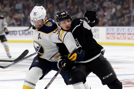 Buffalo Sabres' Marcus Johansson (90) works against Los Angeles Kings' Blake Lizotte (46) during the third period of an NHL hockey game Thursday, Oct. 17, 2019, in Los Angeles. Addition of veteran center has greatly improved Sabres depth and balanced scoring.