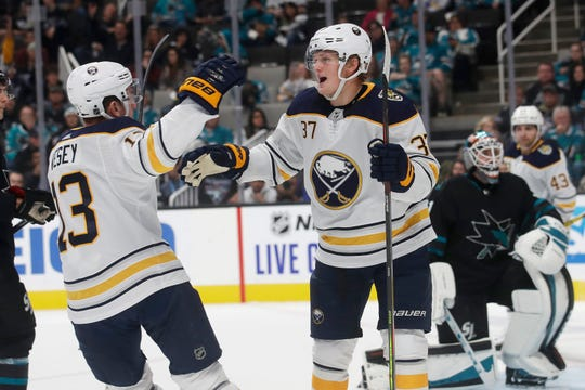 Buffalo Sabres center Casey Mittelstadt (37) is congratulated by left wing Jimmy Vesey after scoring a goal against the San Jose Sharks during the second period of an NHL hockey game in San Jose, Calif., Saturday, Oct. 19.  First-place Sabres are getting scoring from all four lines.