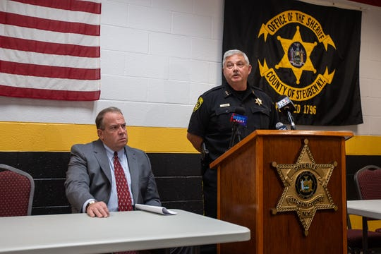 Steuben County Sheriff Jim Allard addresses reporters during a press conference on Monday, Oct. 21, 2019 regarding a crash on Oct. 12 that left four people dead. Steuben County District Attorney Brooks Baker, left, also spoke to the media about prosecuting the case.
