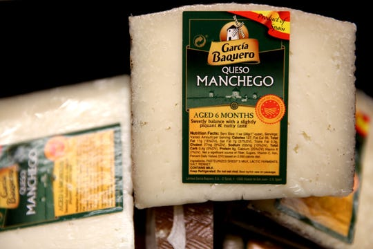 Manchego cheese imported from Spain at LifeSource Natural Foods in Salem on Oct. 21, 2019. A 25% tariff is now in effect for imported specialty food items from certain European countries.
