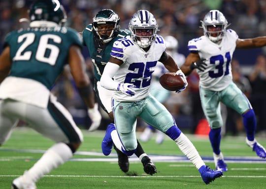 Dallas Cowboys safety Xavier Woods (25) returns his fourth quarter interception against the Philadelphia Eagles at AT&T Stadium.