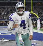 Dallas Cowboys quarterback Dak Prescott celebrates Sunday's rushing touchdown that helped him break the franchise record for touchdowns on the ground by a quarterback.