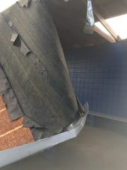 Part of the roof on the visiting team dugout at the Huntington baseball field was destroyed in Monday morning's storm.