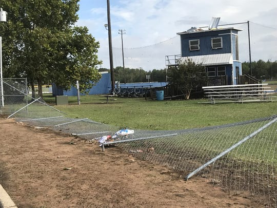 The fence surrounding the Huntington baseball field was destroyed when a possible tornado threw a set of bleachers from another field into the baseball area. Also, the roof on the condemned press box was ripped up.