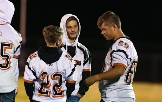 Connor Rentz, center, talks with fellow Dell Rapids teammates on the sidelines of a game against West Central on Friday, October 18, in Hartford.