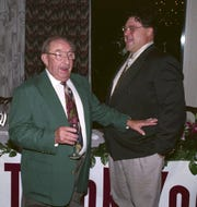 Missouri State University theater professor Howard Orms and actor John Goodman share a laugh during a party in 1993.