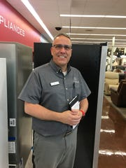 Matthew Ferreira poses for a photo at Boulevard Home Furnishings in Mesquite, where he works. Ferreira fired a 636 series at the Virgin River Bowling Center last week in his return after a 17-year hiatus from the sport.