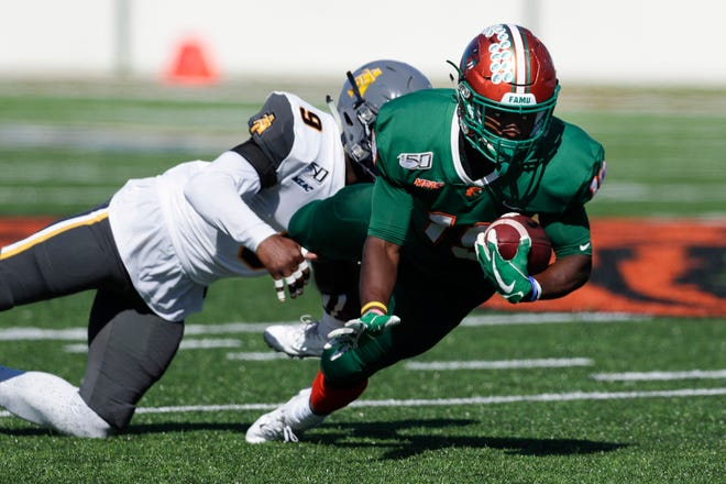 FAMU wide receiver Xavier Smith dives for a first down against North Carolina A&T at Bragg Memorial Stadium Sunday, Oct. 20, 2019.