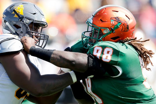 FAMU defensive lineman Jacques Penney (98) takes on a blocker during a game versus North Carolina A&T at Bragg Memorial Stadium Sunday, Oct. 20, 2019.