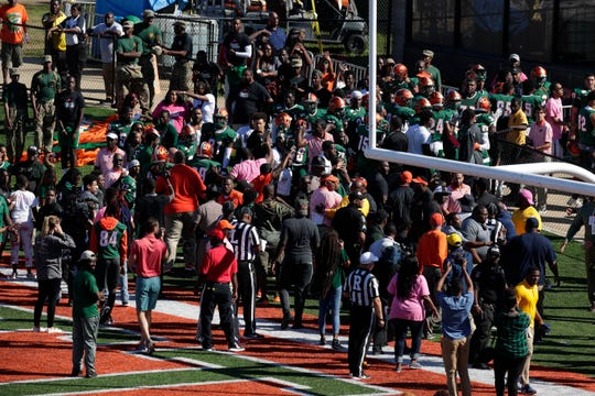 FAMU coaches direct players off the field following a skirmish with North Carolina A&T while walking to the locker room for halftime. The Rattlers won 34-31 in overtime at Bragg Memorial Stadium Sunday, Oct. 20, 2019.