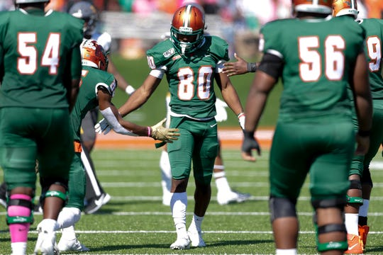FAMU wide receiver Marcus Williams (80) congratulates his teammates for their blocking after a long kickoff return versus North Carolina A&T at Bragg Memorial Stadium Sunday, Oct. 20, 2019.