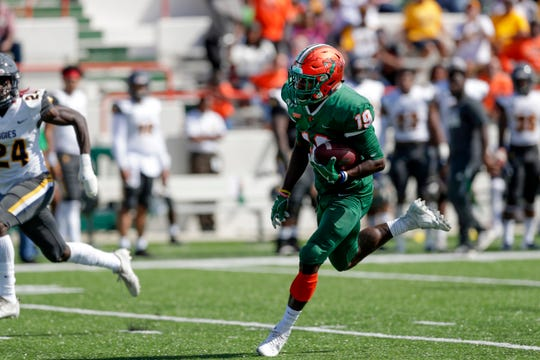 Florida A&M's Xavier Smith (19) runs the ball during a game between FAMU and North Carolina A&T at Bragg Memorial Stadium Sunday, Oct. 20, 2019.