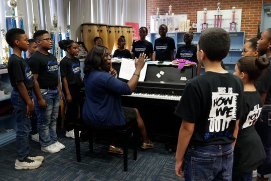Music teacher Arnekua Jackson leads the Hartsfield Elementary School advanced chorus as they practice in her classroom Thursday, Oct. 10, 2019. The group is currently in the process of trying to raise money for a trip to perform at Carnegie Hall.