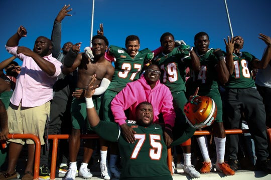 Florida A&M players celebrate after defeating North Carolina A&T State 34-31 in overtime at Bragg Memorial Stadium Sunday, OCt. 20, 2019.