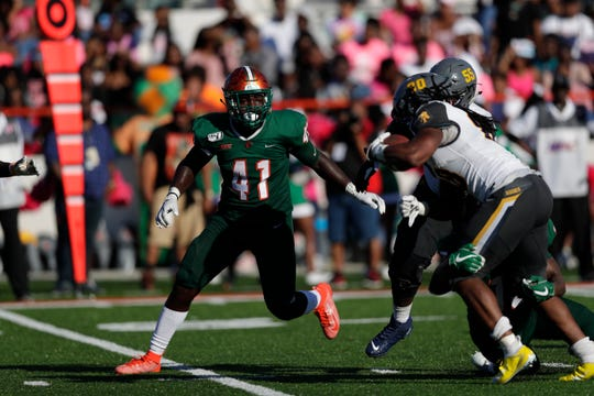 FAMU linebacker Doyle Grimes closes in on North Carolina A&T running back Jah-Maine Martin. The Rattlers won 34-31 in overtime on Sunday, Oct. 20, 2019.