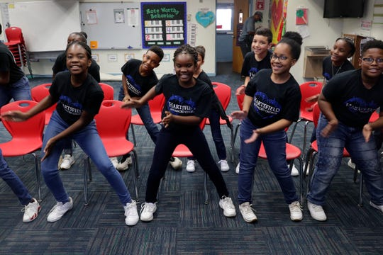The Hartsfield Elementary School advanced chorus, lead by Arnekua Jackson, practices at the school Thursday, Oct. 10, 2019. The group is currently in the process of trying to raise money for a trip to perform at Carnegie Hall.