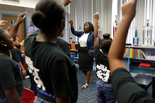 Music teacher Arnekua Jackson leads the Hartsfield Elementary School advanced chorus at the school Thursday, Oct. 10, 2019. The group is currently in the process of trying to raise money for a trip to perform at Carnegie Hall.