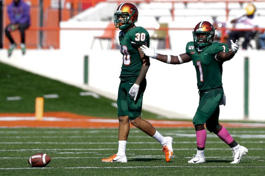 FAMU cornerback Troy Hilton (30) and nickelback Terry Jefferson walk to the line of scrimmage to cover their receivers.
