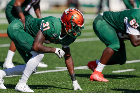 FAMU defensive end Isaiah Land waits for the snap at the line of scrimmage during a game North Carolina A&T at Bragg Memorial Stadium Sunday, Oct. 20, 2019.