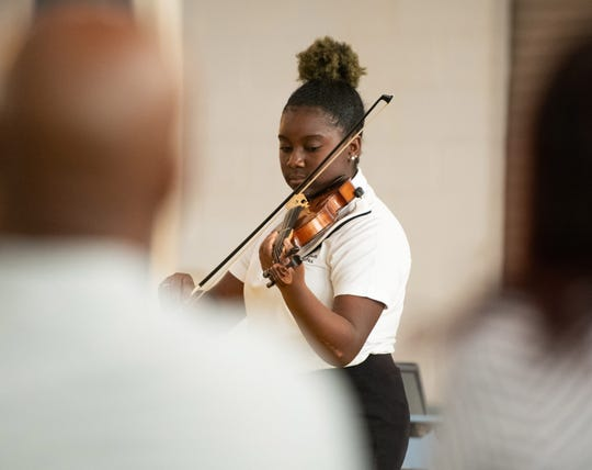 Jada Alexandria Powell performs at the American Black History Program featuring the Gifford Youth Orchestra at the Gifford Community Center on Feb. 23, 2019.