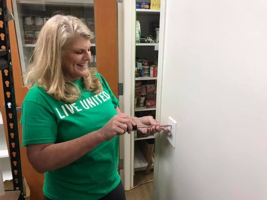 Jann Widmayer from Fort Pierce Utilities Authority volunteers at The Salvation Army during the United Way of St. Lucie County's Day of Caring on Oct. 12, 2019.