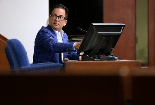 El Paso historian Dr. Max Grossman testifies in the 384th District Court Monday with Judge Patrick Garcia presiding trying to get another demolition injunction for the Duranguito neighborhood. The previous injunction expired in the day of the hearing.