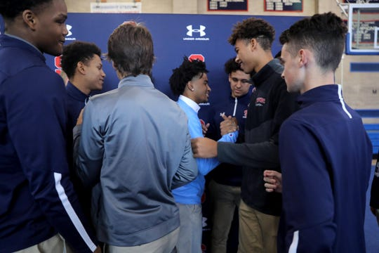 Stepinac basketball star R.J. Davis is greeted by this teammates after announcing that he has committed to attending the University of North Carolina next year. He made the announced Oct. 21, 2019 at Archbishop Stepinac High School.