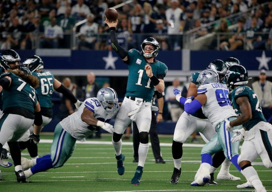 Dallas Cowboys defensive tackle Antwaun Woods (99) pressures Philadelphia Eagles' Carson Wentz (11) on a pass attempt in Arlington, Texas, Sunday, Oct. 20, 2019.