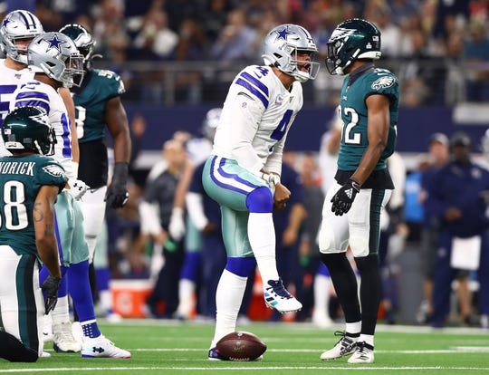 Oct 20, 2019; Arlington, TX, USA; Dallas Cowboys quarterback Dak Prescott (4) celebrates after getting a first down on a sneak in the first quarter against the Philadelphia Eagles at AT&T Stadium.