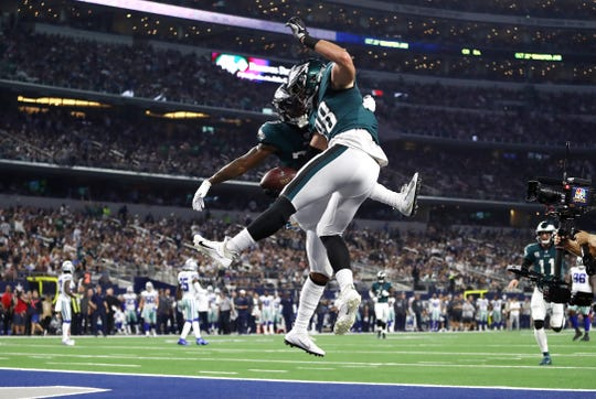 Dallas Goedert (88) of the Philadelphia Eagles celebrates scoring a touchdown during the first quarter against the Dallas Cowboys in the game at AT&T Stadium on Sunday, Oct. 20, 2019 in Arlington, Texas.