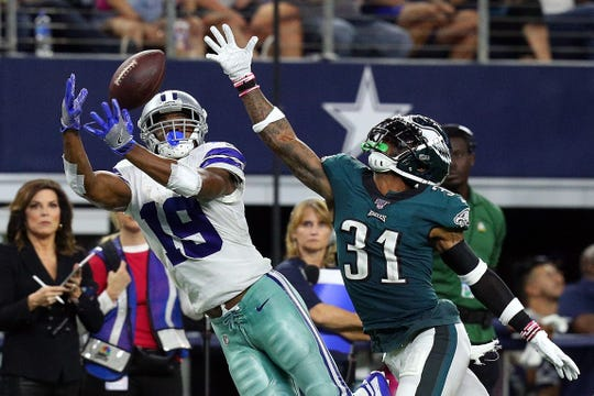 Amari Cooper (19) of the Dallas Cowboys catches a pass against Jalen Mills (31) of the Philadelphia Eagles in the fourth quarter at AT&T Stadium in Arlington, Texas, on Sunday, Oct. 20, 2019.