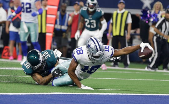 Dallas Cowboys wide receiver Randall Cobb (18) is tackled short of the goal line by Philadelphia Eagles cornerback Orlando Scandrick (38) in the second quarter at AT&T Stadium.