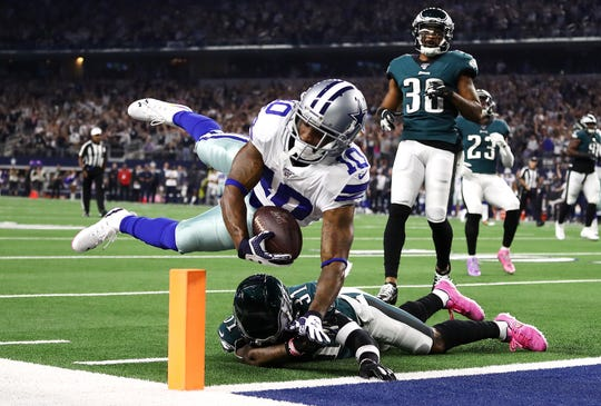 Tavon Austin #10 of the Dallas Cowboys scores a 20-yard rushing touchdown during the first quarter against the Philadelphia Eagles in the game at AT&T Stadium on October 20, 2019 in Arlington, Texas.