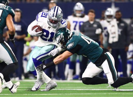 Oct 20, 2019; Arlington, TX, USA; Dallas Cowboys running back Ezekiel Elliott (21) runs with the ball in the first quarter against Philadelphia Eagles linebacker Nathan Gerry (21) at AT&T Stadium.