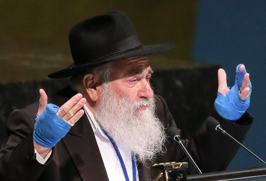 FILE - In this June 26, 2019, file photo, Rabbi Yisroel Goldstein, senior rabbi of Chabad of Poway synagogue in San Diego, Calif., address the United Nations General Assembly's meeting on combating antisemitism and other forms of racism and hate in the digital age at U.N. headquarters. A Jewish civil rights group says at least a dozen white supremacists have been arrested on allegations of plotting, threatening or carrying out anti-Semitic attacks in the U.S. since the massacre at a Pittsburgh synagogue in 2018. The Anti-Defamation League's Center on Extremism's tally of the arrests includes the April 2019 capture of John T. Earnest, who is charged with killing one person and wounding three others in a shooting at the Poway synagogue. (AP Photo/Bebeto Matthews, File)