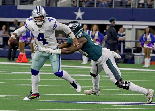 Dallas Cowboys Dak Prescott is almost sacked by Philadelphia Eagles Josh Sweat but throws the ball out of bounds Sunday, Oct. 20, 2019, at AT&T Stadium in Arlington.