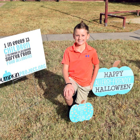 Ollie Brown, 8, a fourth-grader at Bowie Intermediate School, wants to spread awareness of food allergies by promoting the Teal Pumpkin Project campaign. Certain foods can cause Ollie to have choking, bowel and skin issues.