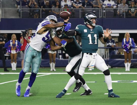 Dallas Cowboys Robert Quinn disrupts Philadelphia Eagles quarterback Carson Wentz Sunday, Oct. 20, 2019, at AT&T Stadium in Arlington.