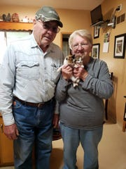 Foster parents, Bob and Susan, with Smudge and Ghost.