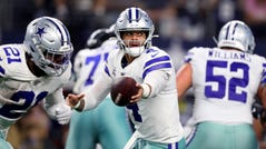 Dak Prescott of the Dallas Cowboys hands the ball off against the Philadelphia Eagles in the second half at AT&T Stadium on October 20, 2019 in Arlington, Texas.