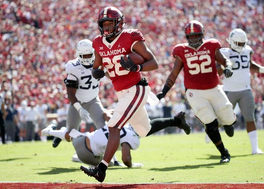 Oklahoma running back Kennedy Brooks scores a touchdown during the second quarter against the West Virginia.