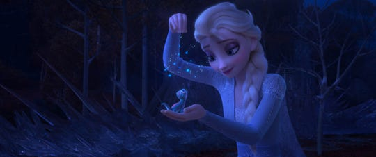 "Elsa plays with Bruni, a salamander, in the movie ""Frozen 2."""