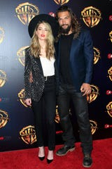 """Amber Heard and Jason Momoa appeared together at CinemaCon 2018. Heard subbed her """"Aquaman"""" co-star's head and body for her own in an Instagram post to show the platform's inconsistent policy on nudity."""