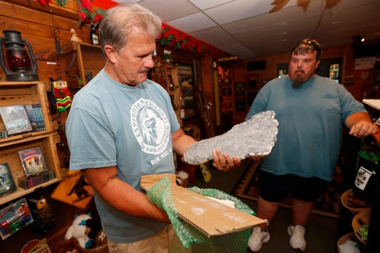This Aug. 8, 2019, photo shows Bigfoot researcher David Bakara opening a box containing plaster cast of footprints said to be from a Russian Bigfoot at Expedition: Bigfoot! The Sasquatch Museum in Cherry Log, Ga.  Bakara, a longtime member of the Bigfoot Field Researchers Organization who served in the Navy, drove long-haul trucks and tended bar before opening the museum in early 2016 with his wife, Malinda.