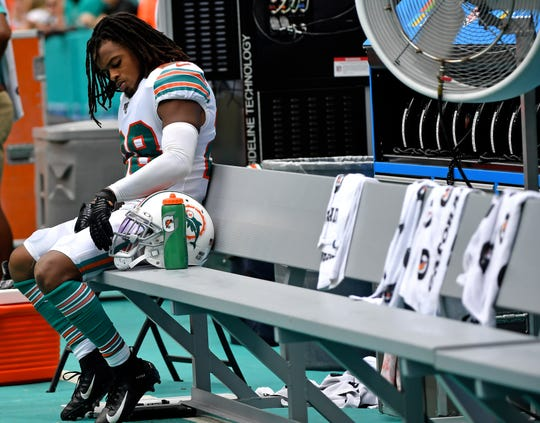 Miami Dolphins strong safety Bobby McCain (28) sits on the bench against the New England Patriots during the second half at Hard Rock Stadium.